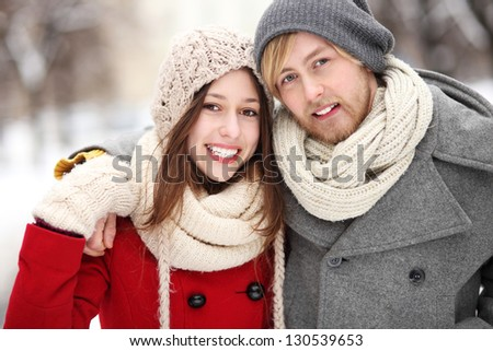 Couple in winter clothing - stock photo