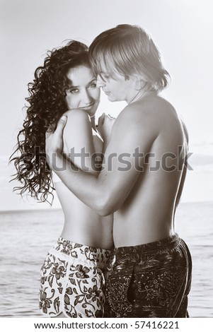 Couple inlove embrace near the sea. - stock photo
