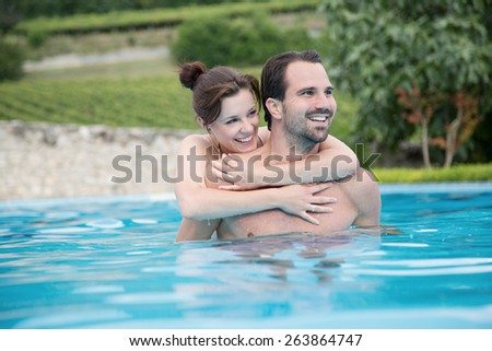 couple is swimming in a schwimming pool  - stock photo