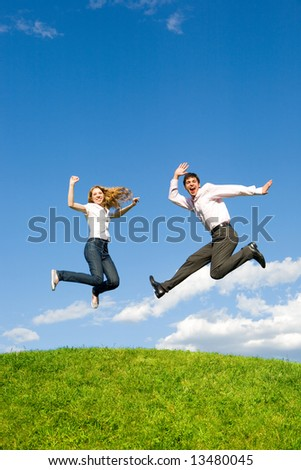 Couple jumping - stock photo