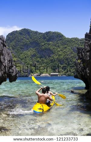Couple kayaking - stock photo