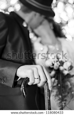 Couple kiss. Focus on ring - stock photo