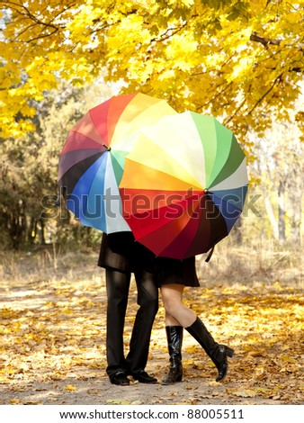 Couple kissing at alley in the park. - stock photo