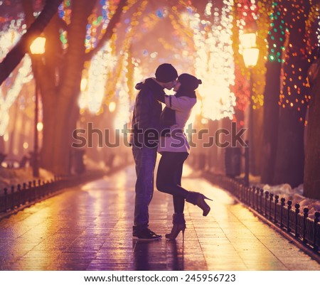 Couple kissing at night alley.  - stock photo
