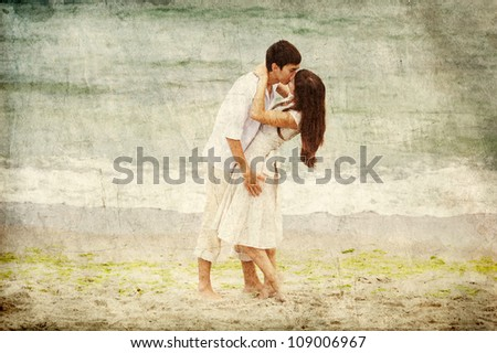 Couple kissing at the beach. Photo in old retro style. - stock photo