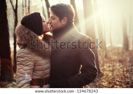 couple kissing on the nature - stock photo