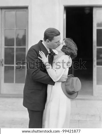 Couple kissing outside - stock photo