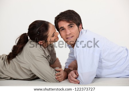 Couple laying together - stock photo