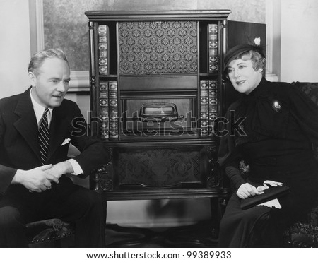 Couple listening to radio - stock photo