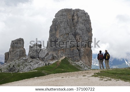 couple looking at mountains - stock photo