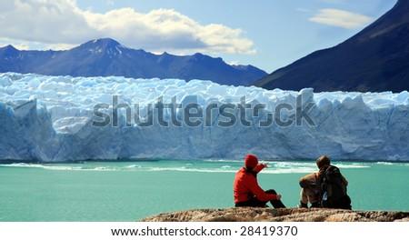 Couple looking at Perito Moreno Glacier, Patagonia, Argentina - stock photo