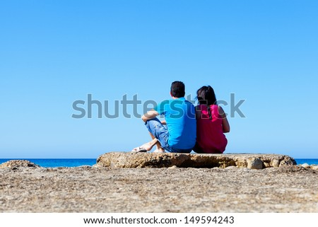 Couple Looking at Sea in an Old Dock, Mallorca - stock photo