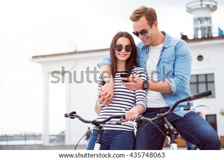 Couple looking at the smartphone - stock photo