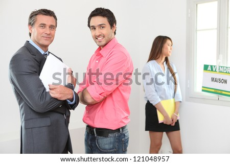 Couple looking round a property - stock photo