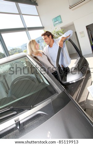 Couple looking to buy a new car - stock photo