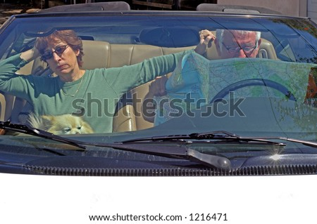 Couple lost in car, man won't ask directions - stock photo