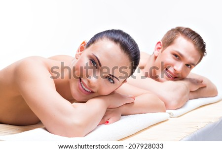 Couple lying on the massage desks on the spa salon. Beauty treatment concept. - stock photo