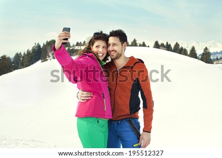 couple making a selfie on the snow - stock photo