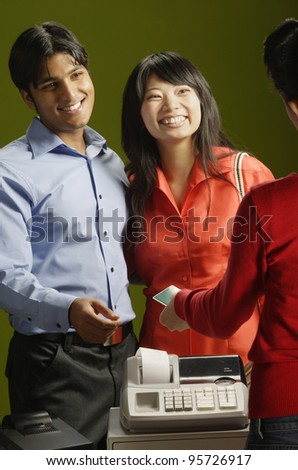 Couple making credit card purchase - stock photo