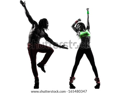 couple man and woman exercising fitness dancing in silhouette on white background - stock photo