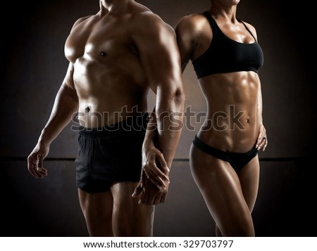 Couple man and woman muscled and bodybuilder - stock photo