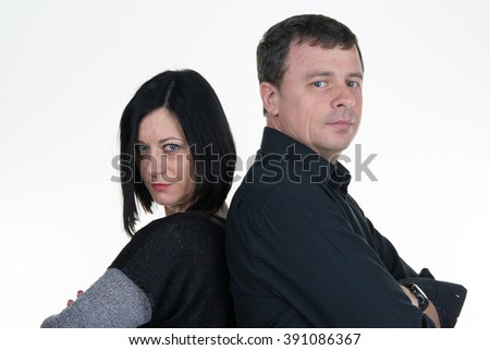 Couple mid aged standing back to back having relationship difficulties. Isolated on white background - stock photo