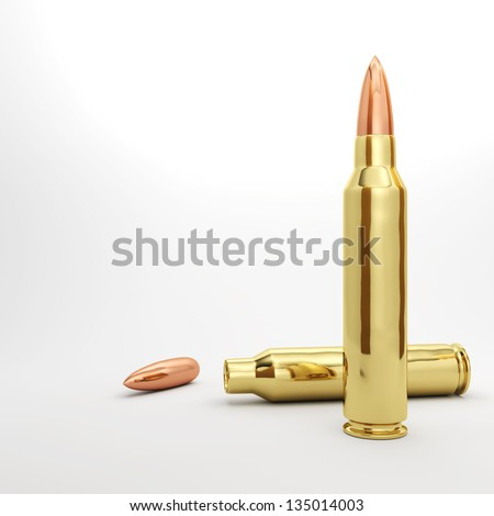 Couple 5.56mm rifle bullets spread out. - stock photo