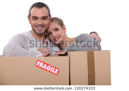 Couple moving cartons - stock photo