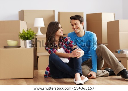 Couple moving in house - stock photo