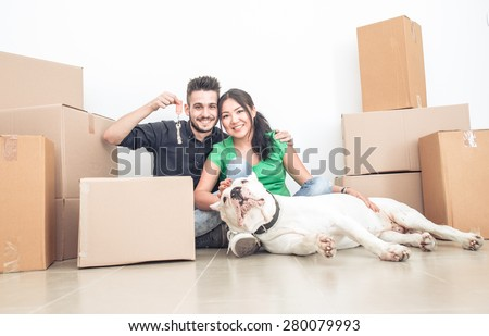 couple moving new home. concept about real estate, couples, relationships, and people - stock photo