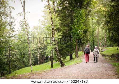 Couple  Nature.Retired Nature.Relaxing Outdoors.Pensioners Walk.Senior Couple.Happy Seniors. Health Seniors.Health pensioners.Elderly Couple Walk.Man Retirement.Retired Woman.Active Seniors. - stock photo