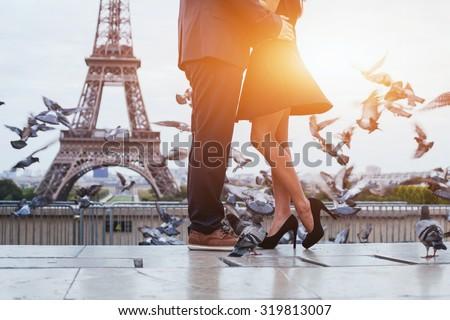 couple near Eiffel tower in Paris, romantic kiss - stock photo