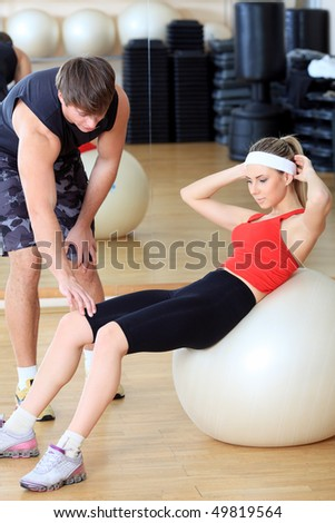 Couple of a sporty young people in the gym. - stock photo