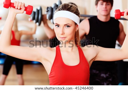 Couple of a sporty young people in the gym centre. - stock photo