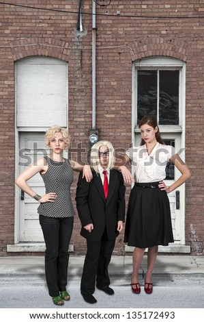 Couple of beautiful young women and a boy who are the best of friends - stock photo