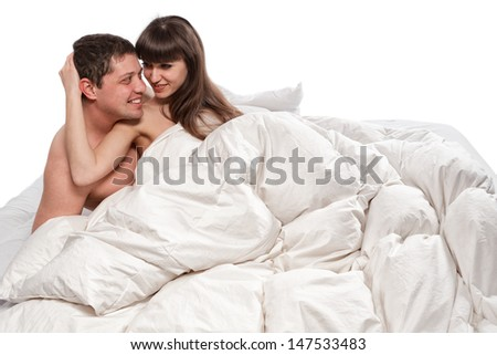 Couple of beauty lovers in bed on white background - stock photo