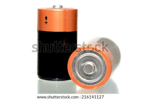 Couple of big type D batteries isolated on white - stock photo