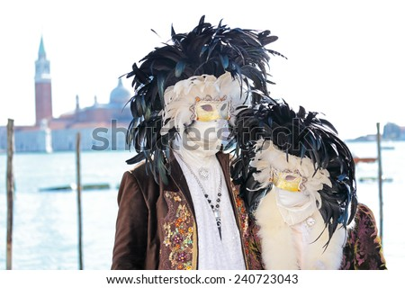 Couple of black and white masks decorated with feathers exhibited during the traditional Carnival of Venice, Italy (2014 edition) - stock photo