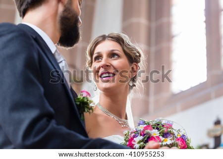 Couple of bride and groom having wedding in church - stock photo