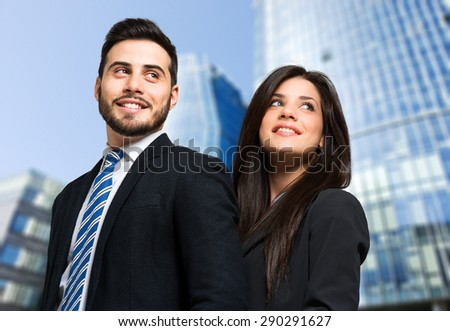 Couple of business people outdoor - stock photo