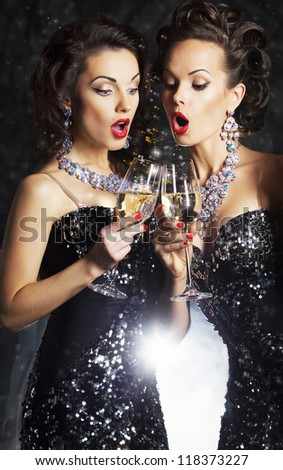 Couple of cheerful women toasting at party with wineglasses - celebration. Formal Party - stock photo