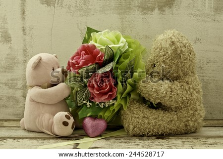 couple of cute  bears holding roses bouquet - stock photo