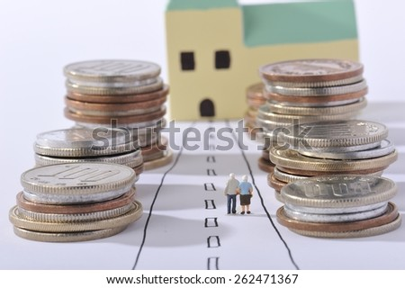 Couple of elderly walking the road surrounded by money - stock photo