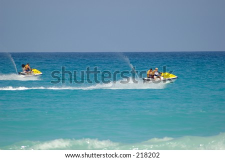 Couple of fast jetskis in the coasts of Cancun. - stock photo