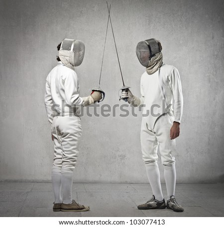 Couple of fencers before the match - stock photo