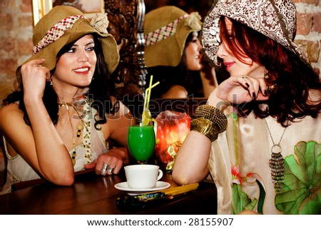 couple of girlfriends in cafe - stock photo