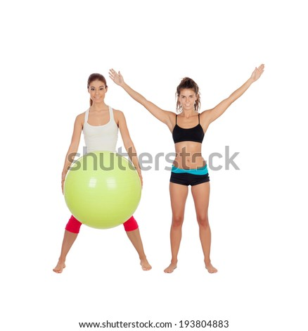 Couple of girlfriends with fitness clothes isolated on a white background - stock photo