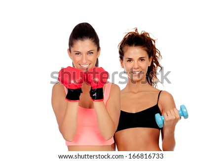 Couple of girls playing sports in gym isolated on white background - stock photo