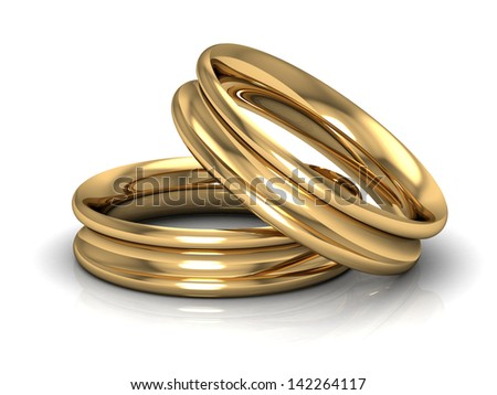 couple of gold wedding rings on white background - stock photo