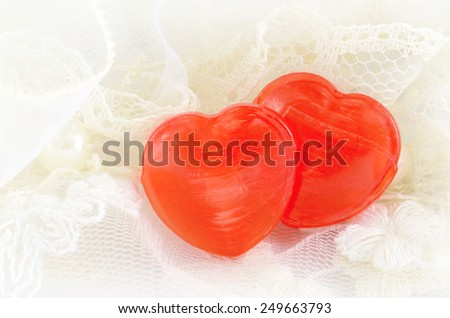 Couple of Heart Candy on Soft Creamy Background. Happy Valentine's Day on 14th February. - stock photo